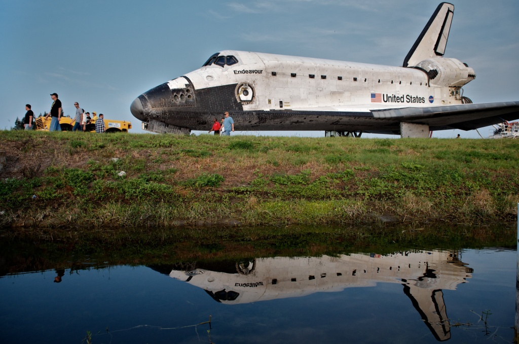 Space Shuttle Endeavour is escorted back to a storage building following its last mission before being retired, at Kennedy Space Center, on June 01, 2011, in Cape Canaveral, Florida. Endeavour, completing a 16-day mission to outfit the International Space Station, spent 299 days in space and travelled more than 122.8 million miles during its 25 flights. It launched on its first mission on May 7, 1992.