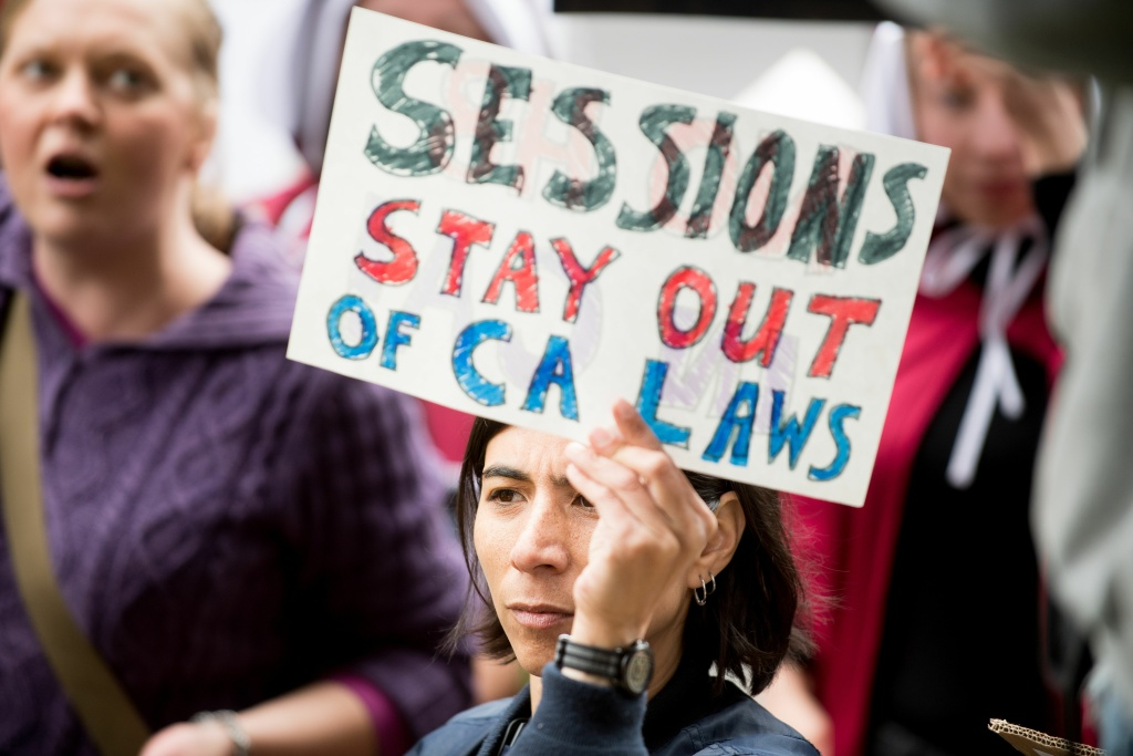 People protest outside a speech by US Attorney General Jeff Sessions March 7, 2018, in Sacramento, California.