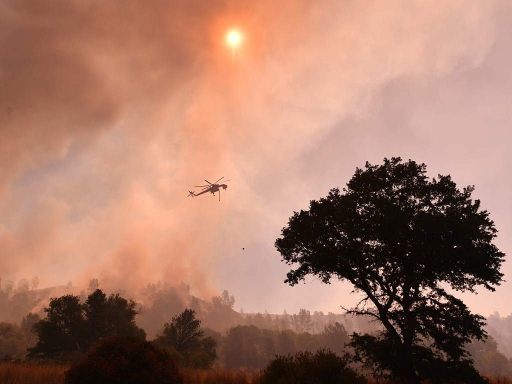 Extreme heat and dry conditions this week have contributed to a number of powerful fires across California, destroying property, prompting evacuations and causing at least one death.