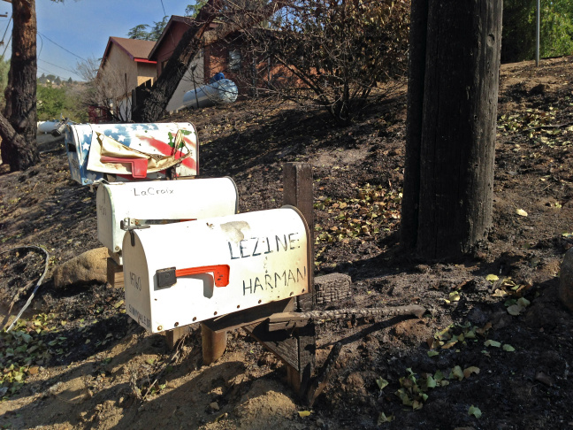 Near Elizabeth Lake, a mailbox was burned, but the house was saved. Across the street, a forest was decimated.