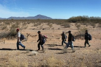 Undocumented Mexican immigrants walk through the Sonoran Desert after illegally crossing the U.S.-Mexico border.