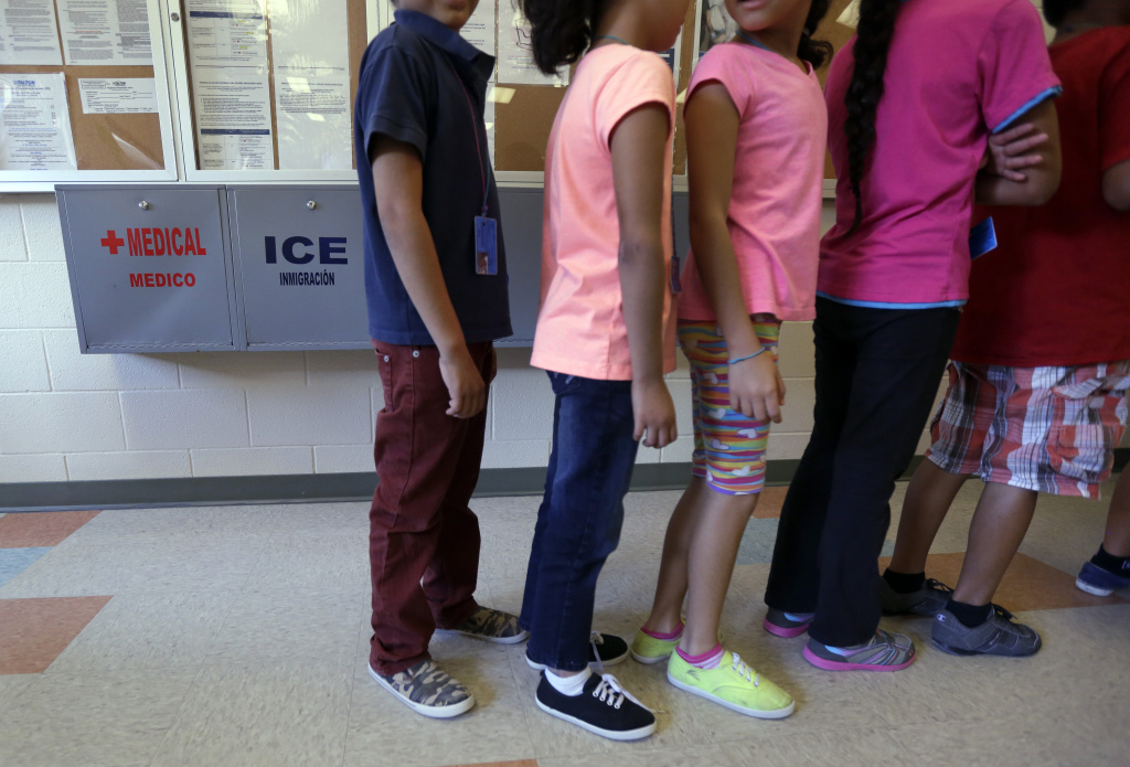 In this Sept. 10, 2014 file photo, detained immigrant children line up in the cafeteria at the Karnes County Residential Center, a temporary home for immigrant women and children detained at the border, in Karnes City, Texas. The number of Central American families and unaccompanied minors arriving at the border this fall more than doubled from the year before, according to the most recent figures.