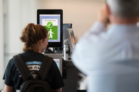 A woman boarding a SAS flight to Copenhagen goes through facial recognition verification system VeriScan at Dulles International Airport in Dulles, Virginia, on September 6, 2018
