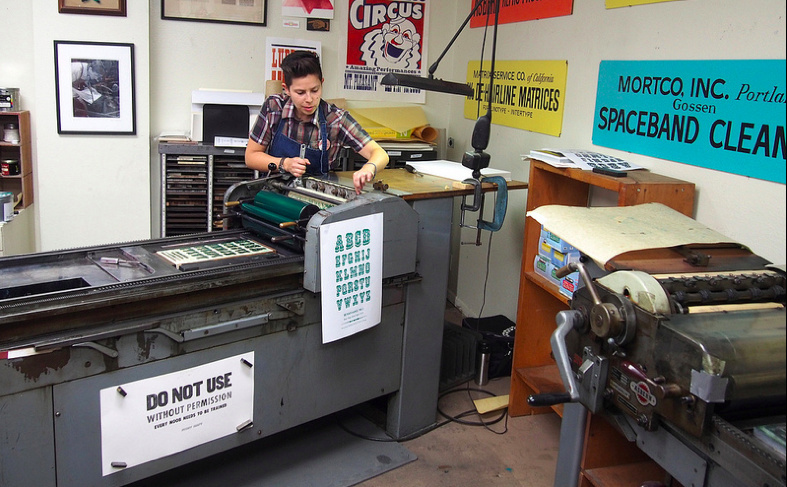 A printer at the LA International Printers Fair. A new report on the state's creative economy includs a wide range of creative industries, including printing and publishing.