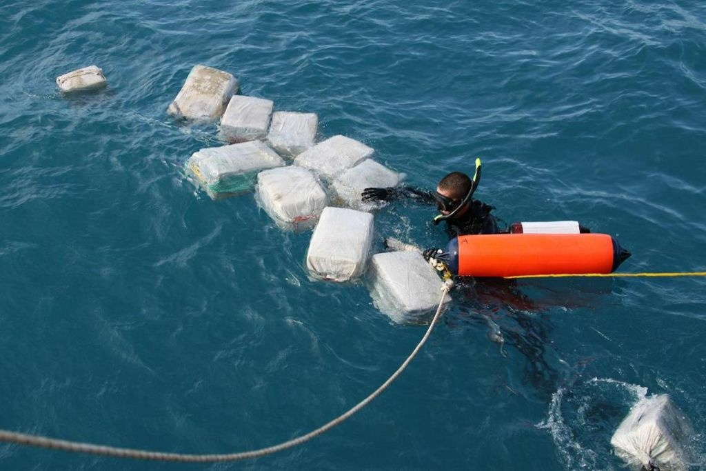 In this handout provided by U.S. Coast Guard, he crew of the Coast Guard Cutter Seneca interdicts a drug smuggling, self-propelled semi-submersible (SPSS) vessel carrying cocaine on an unspecified date in the western Caribbean Sea. It was the first interdiction of an SPSS in the Caribbean.