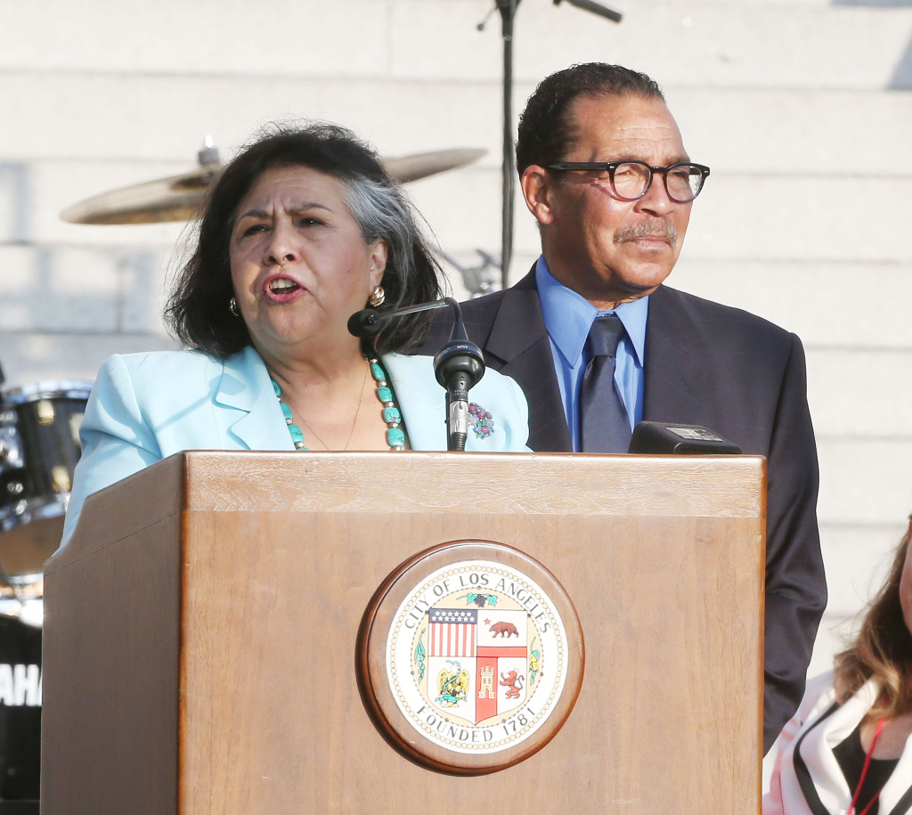 Supervisor Gloria Molina (L) and Council President Herb Wesson speak during a tribute to Mayor Antonio Villaraigosa at Celebrate LA! on June 7, 2013. Molina is one of two supervisors who moved to sever ties with a troubled foster care agency. (Photo by Frederick M. Brown/Getty Images)