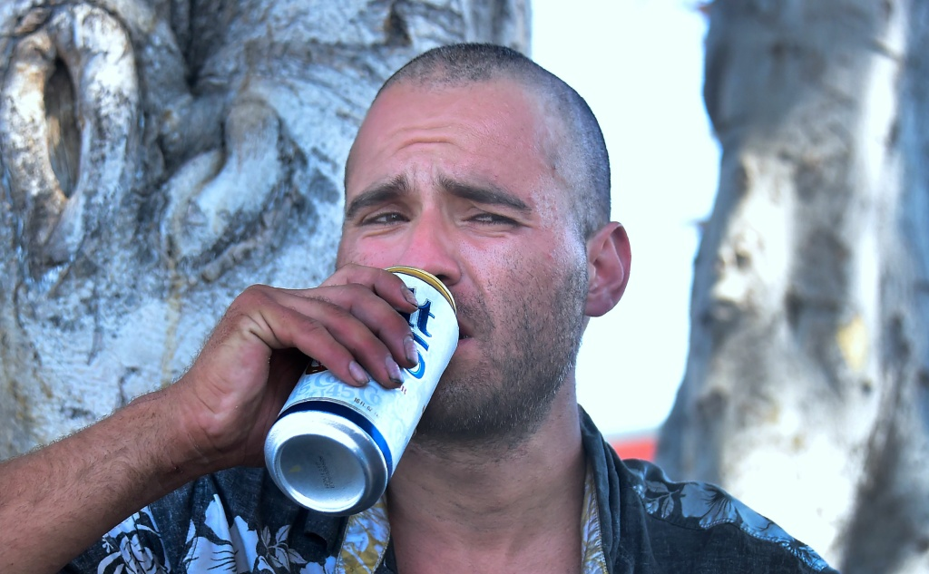 Homeless veteran Joseph Shokrian has a beer while reflecting on past experiences in his life with journalists on a streetcorner near Skid Row in downtown Los Angeles, California on June 20, 2017.