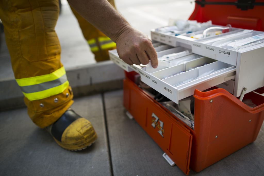 File: Firefighter paramedic Fred Gonzalez of Los Angeles County Fire restocks medical supplies after dropping off a patient at UCLA Medical Center and Orthopedic Hospital in Santa Monica on Monday morning, August 31, 2015. A UCLA-run pilot program starting Sept. 1 in Glendale and Santa Monica aims to reduce overcrowding, while also freeing up paramedics who get stuck waiting to pass off ER patients.