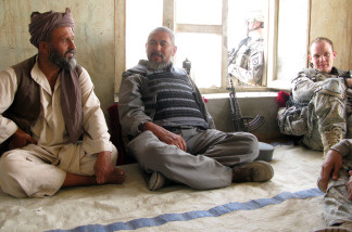 U.S. Army 1st Lt. Mike Kehoe (right) sits down for a chat with a village elder and the local police chief in Ali Abad, Kunduz.