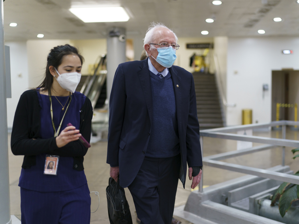 Sen. Bernie Sanders returns to his office on March 5, 2021, while the Senate works on the Democrats' $1.9 trillion COVID-19 relief bill. Sanders calls the recently passed package