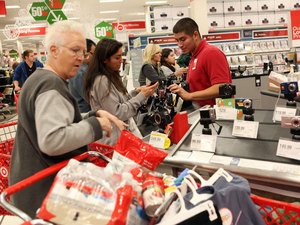 Target shoppers look for Black Friday deals in Los Angeles. U.S. consumers increased their spending at retail businesses in December 2012, buying more autos, furniture and clothing. File photo.