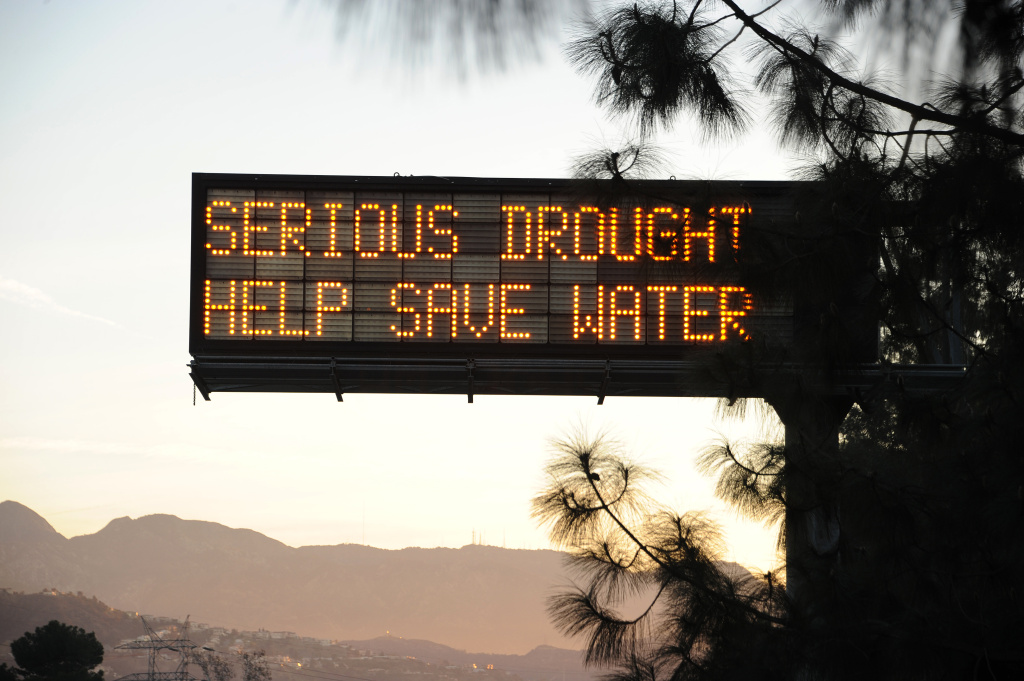 A sign over a highway in Glendale, California warns motorists to save water in response to the state's severe drought, February 14, 2014.  US President Barack Obama is visiting drought-stricken California today and is expected to announce more than $160 million in federal financial aid to help California recover from the crippling drought that is threatening the state's agriculture industry. AFP PHOTO / ROBYN BECK        (Photo credit should read ROBYN BECK/AFP/Getty Images)