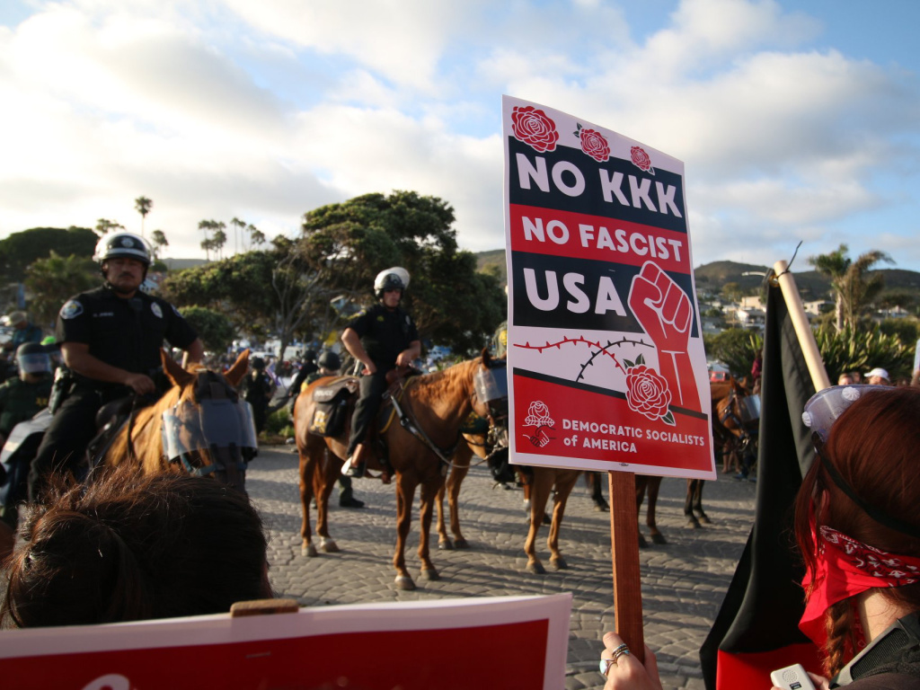 Counter-protestors demonstrate at an anti-immigration rally in Laguna Beach on Sunday, August 20, 2017.