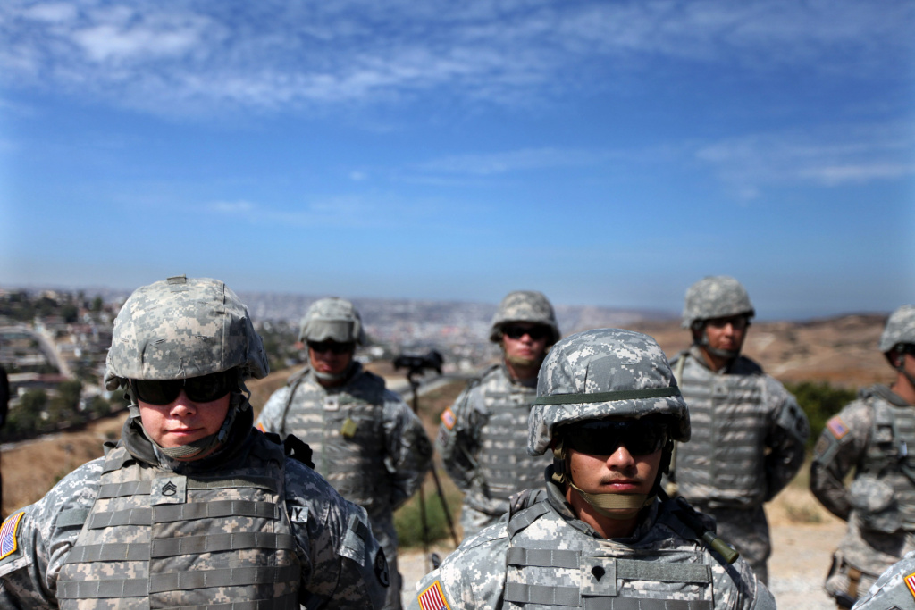 National Guardsmen stand in formation along the U.S.-Mexico border in California in this August 18, 2010 file photo. Nearly 10,000 state guardsmen were told by the Pentagon earlier this year they would need to return their reenlistment bonuses because they were paid without proper authorization, but a bill passed by the U.S. Senate Thursday would let many of them keep the money.