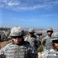 National Guardsmen stand in formation along the U.S.-Mexico border on August 18, 2010 in San Ysidro, California.