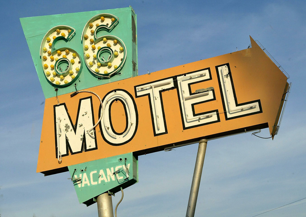 This photo shows the sign outside the 66 Motel in Needles, California on July 12, 2003. Needles is one town along the 2,248 miles of the former Route 66 which has become a shadow of its former self since it was bypassed by Interstate 40, ravishing its businesses and commerce.