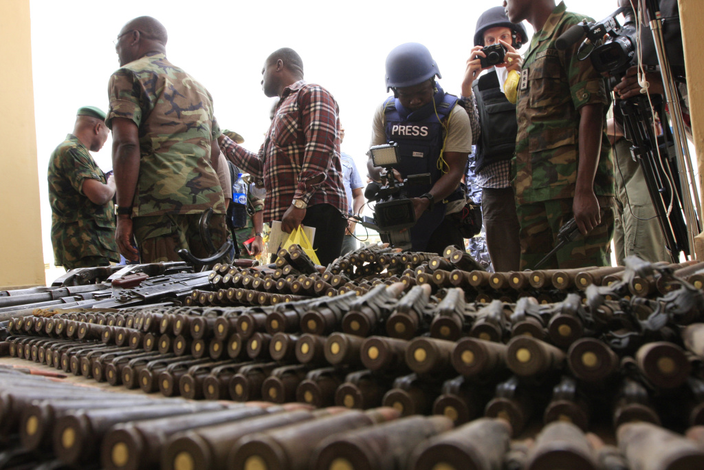 FILE In this Wednesday, June 5, 2013 file photo, journalists look at arms and ammunition which military commanders say they seized from Islamic fighters, in Maiduguri, Nigeria, on Wednesday, June 5, 2013. Boko Haram, the radical group that once attacked only government institutions and security forces, is increasingly targeting civilians.