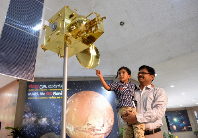 Indian Space Research Organization scientists and other officials cheer as they celebrate the success of Mars Orbiter Mission at their Telemetry, Tracking and Command Network complex in Bangalore, India, Wednesday, Sept. 24, 2014. India triumphed in its first interplanetary mission, placing a satellite into orbit around Mars on Wednesday morning and catapulting the country into an elite club of deep-space explorers. (AP Photo/Aijaz Rahi)
