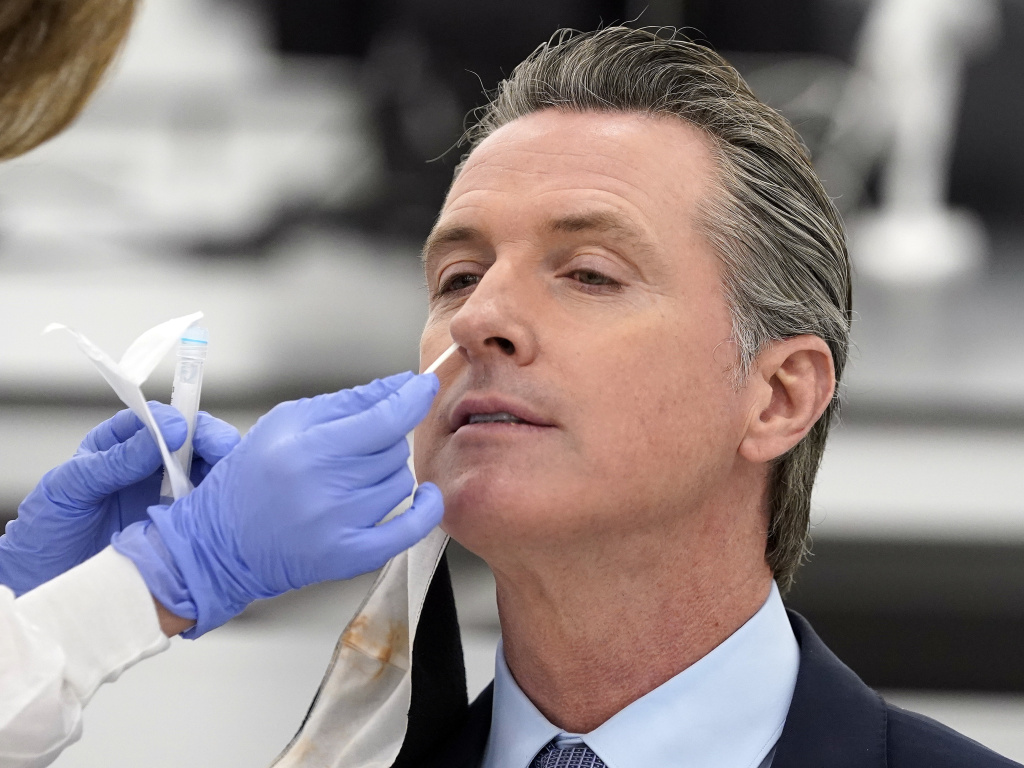 California Gov. Gavin Newsom, pictured receiving a coronavirus test on Oct. 30, apologized to residents on Monday for attending a birthday party with too many guests.