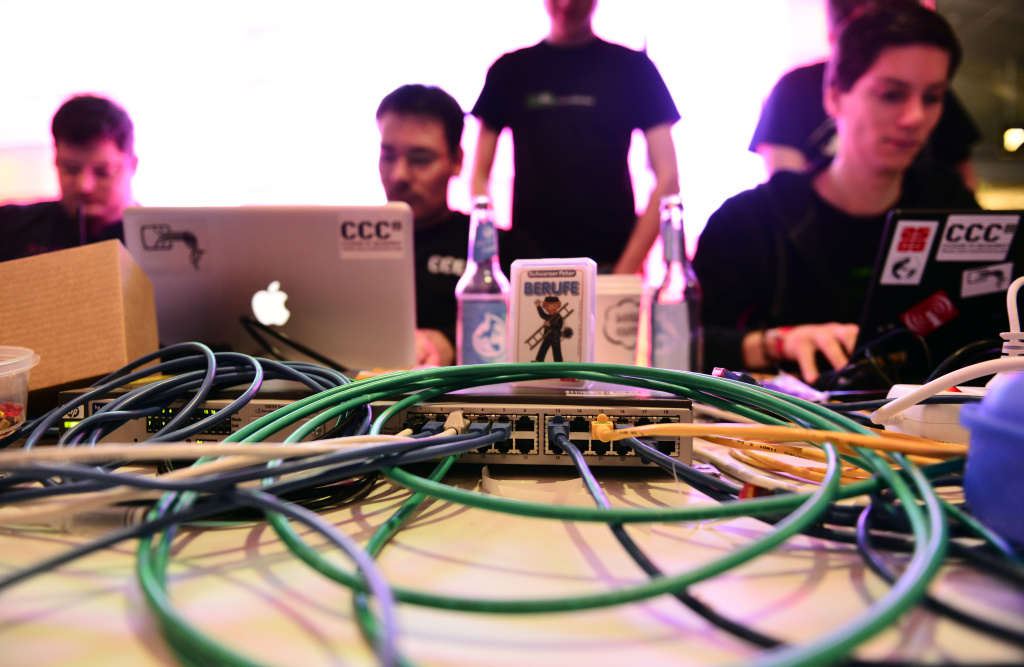 Participants work at their their laptops at the annual Chaos Computer Club (CCC) computer hackers' congress, called 29C3. The FBI is warning state officials to boost their election security in light of evidence that hackers targeted related data systems in two states.