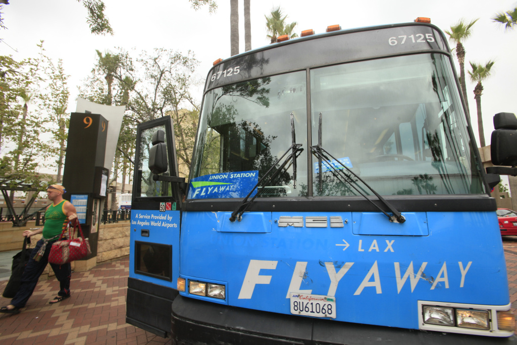 A patron passes the Flyaway shuttle service bus at Union Station Thursday, July 14, 2011, in Los Angeles.