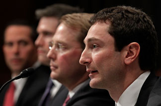 Fabrice Tourre (R), executive director of the structured products group trading for The Goldman Sachs Group, testifies before the Senate Homeland Security and Governmental Affairs Investigations Subcommittee with (L-R) Daniel Sparks, former partner and head of the Mortgages Department at the Goldman Sachs Group, Joshua Birnbaum, former managing director of the structured products group trading for The Goldman Sachs Group and Michael Swenson, managing director of structured products group trading for The Goldman Sachs Group on Capitol Hill on April 27, 2010 in Washington, DC.