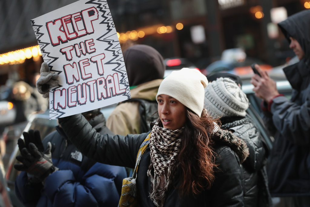 CHICAGO, IL - DECEMBER 07:  Demonstrators, supporting net neutrality, protest a plan by the Federal Communications Commission (FCC) to repeal restrictions on internet service providers during a protest outside a Verizon store on December 7, 2017 in Chicago, Illinois. According to organizers, similar demonstrations have been planned today at 700 Verizon stores in all 50 states.  (Photo by Scott Olson/Getty Images)