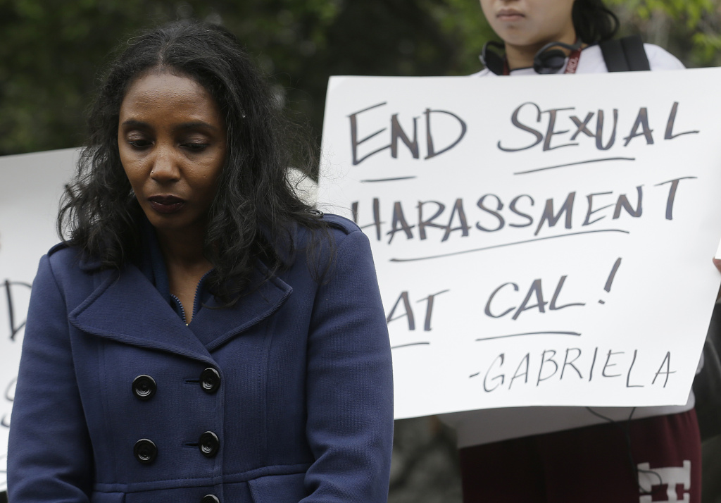 Tyann Sorrell listens to speakers at a news conference on the University of California campus in Berkeley on April 11, 2016. Two graduate students, Kathleen Gutierrez, and Erin Bennett, filed a complaint regarding alleged sexual harassment by a University of California, Berkeley, professor. Sorrell has also made complaints against the same individual for sexual harassment.