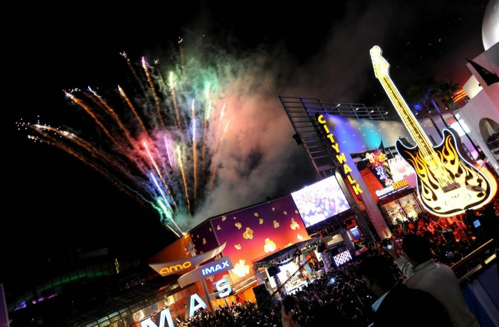 People celebrate on New Year's Eve as fireworks illuminate the sky at the Universal CityWalk early Jan. 1, 2008.