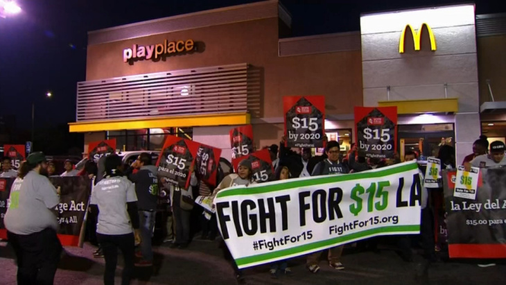 Fast-food workers protest in front of a McDonald's as part of the