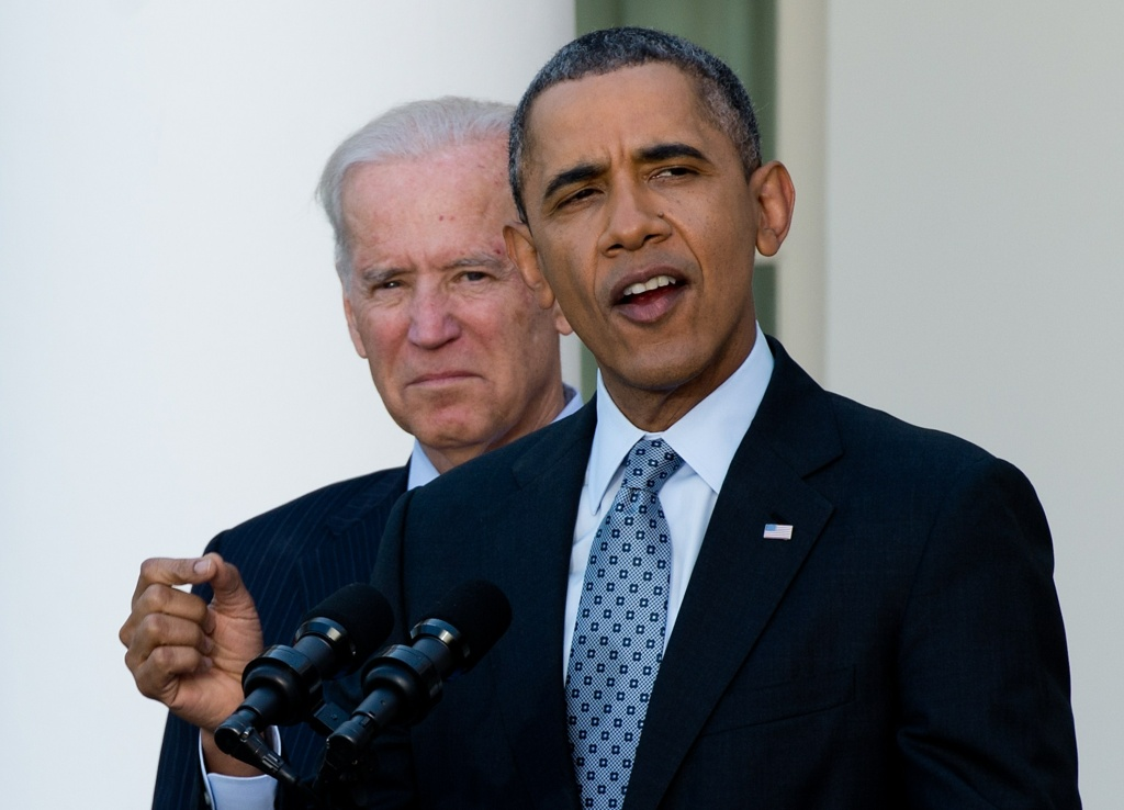 US President Barack Obama speaks about the Affordable Care Act, also known as Obamacare, with Vice President Joe Biden in the Rose Garden at the White House in Washington on April 1, 2014.