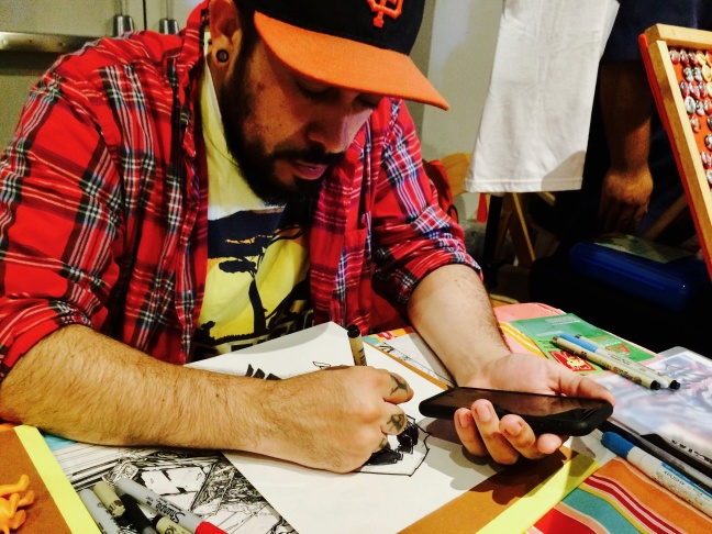 Artist Javier Hernandez co-founded the Latino Comics Expo with Ricardo Padilla.  Both men say the goal was simply to get all Latino/a comic-book artists together under one roof to talk, share and support the field.