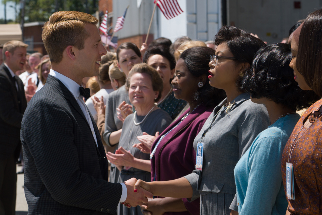 Katherine G. Johnson (Taraji P. Henson), flanked by fellow mathematicians Dorothy Vaughan (Octavia Spencer) and Mary Jackson (Janelle Monáe) meet the man they helped send into orbit, John Glenn (Glen Powell), in HIDDEN FIGURES.