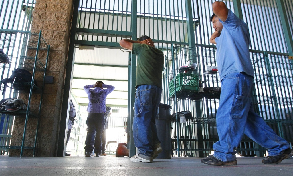 FILE - In this Thursday, Aug. 9, 2012, file photo, suspected illegal immigrants are transferred out of the holding area after being processed at the Tucson Sector of the U.S. Customs and Border Protection headquarters in Tucson, Ariz. The National Immigration Law Center and the ACLU argued in court there are inhumane conditions inside Arizona detention facilities. (AP Photo/Ross D. Franklin, File)