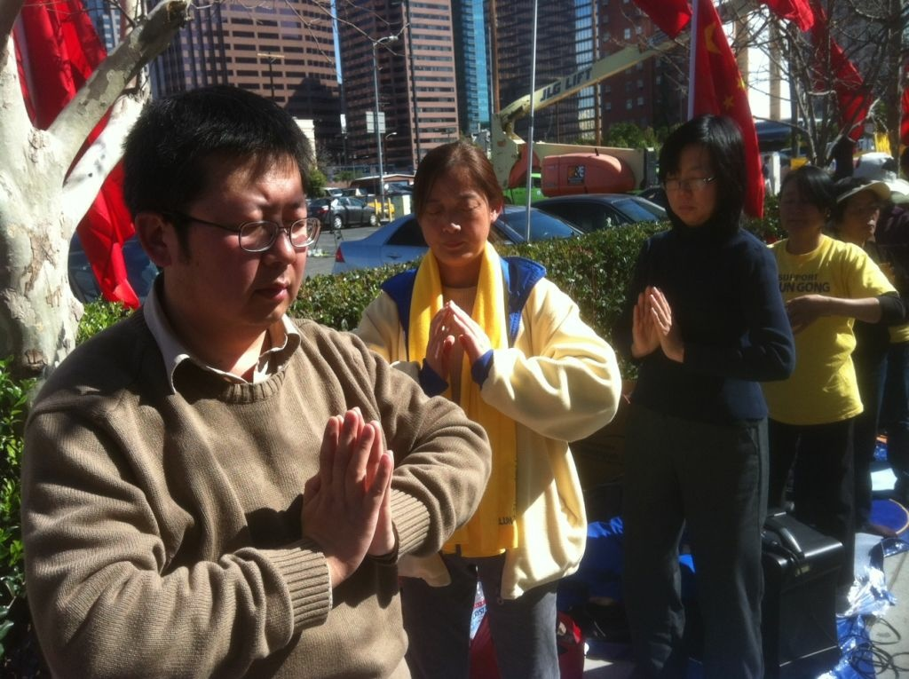 Protestors pray at a Tibetan protest in downtown L.A.