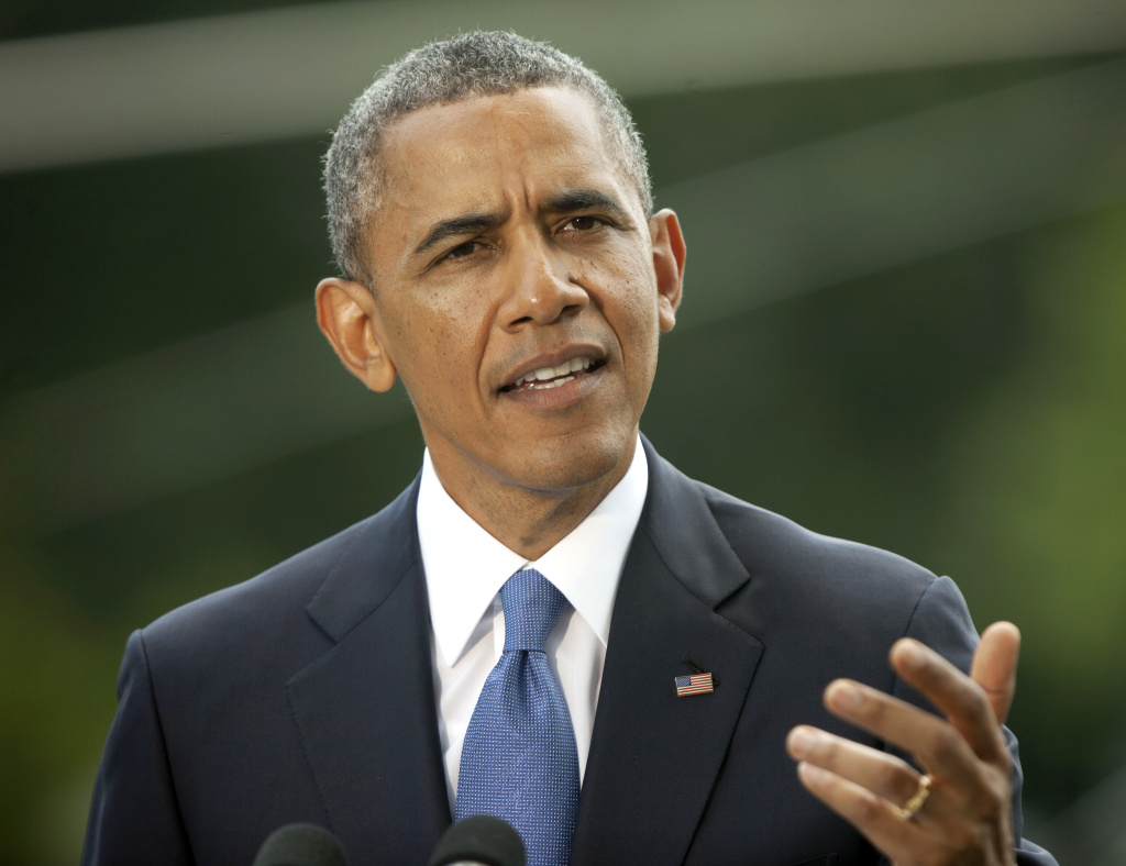 FILE - This June 13, 2014 file photo shows President Barack Obama speaking on the South Lawn of the White House in Washington. President Barack Obama plans to sign an executive order banning federal contractors from discriminating against employees on the basis of their sexual orientation, a White House official said Monday.