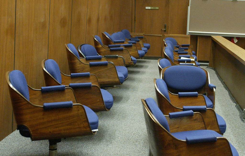 Seats in the jury box sit empty during a hearing at Los Angeles Superior Court.