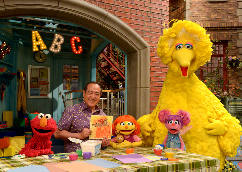 Julia (center) first appeared online and in printed materials as a part of <em>Sesame Street</em>'s<a href=