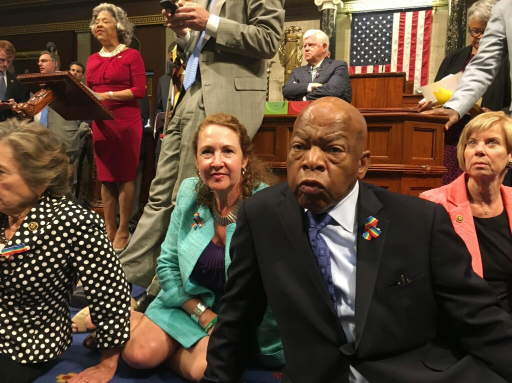 This photo provided by Rep. Chillie Pingree,D-Maine, shows Democratic members of Congress, including Rep. John Lewis, D-Ga., center, and Rep. Elizabeth Esty, D-Conn. as they participate in sit-down protest seeking a a vote on gun control measures.