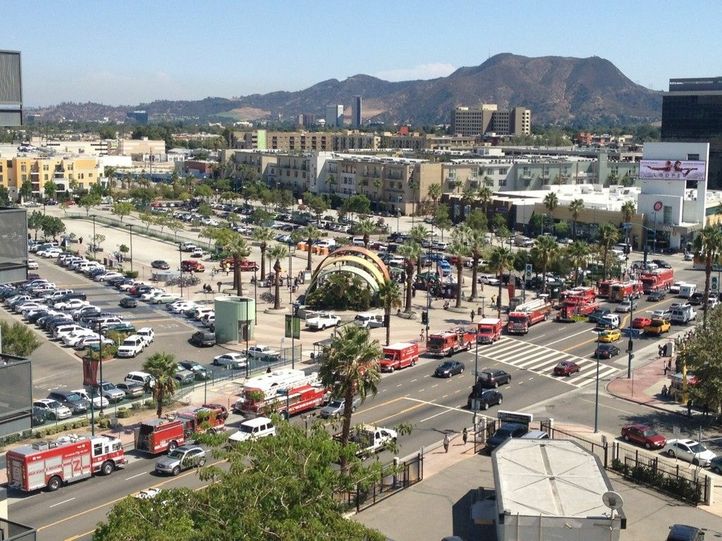 Over a dozen rescue vehicles surround the North Hollywood Red Line station to rescue a person who found themselves beneath a train Tuesday.