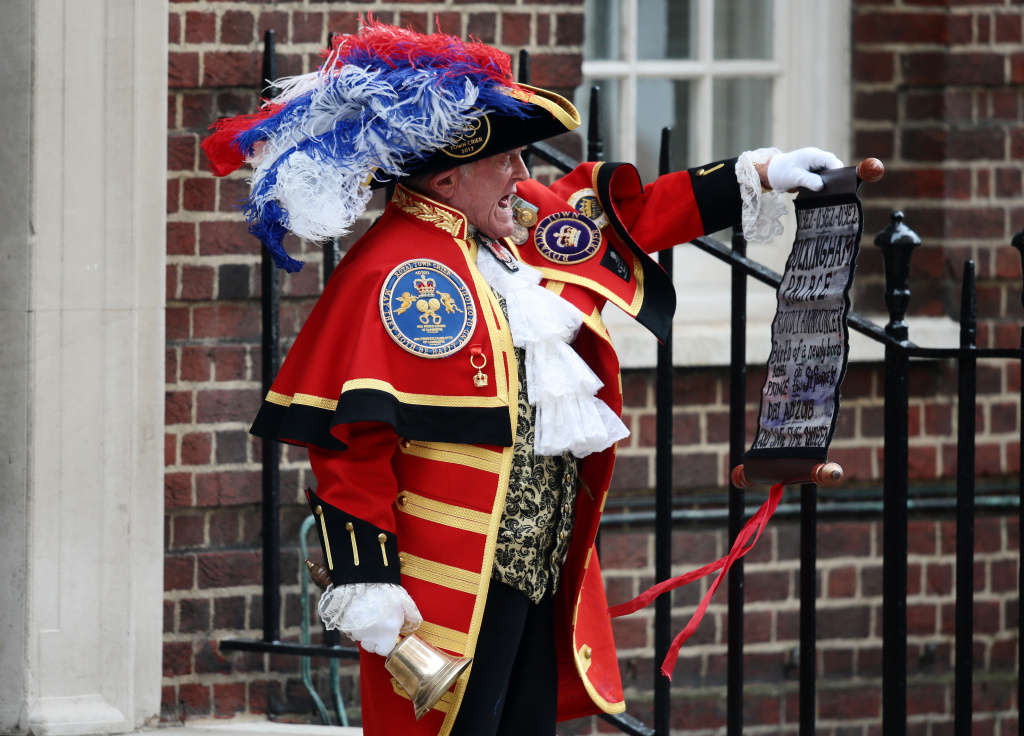 A town crier announces that the Duchess of Cambridge has given birth to a baby boy at St. Mary's Hospital on April 23, 2018 in London, England.