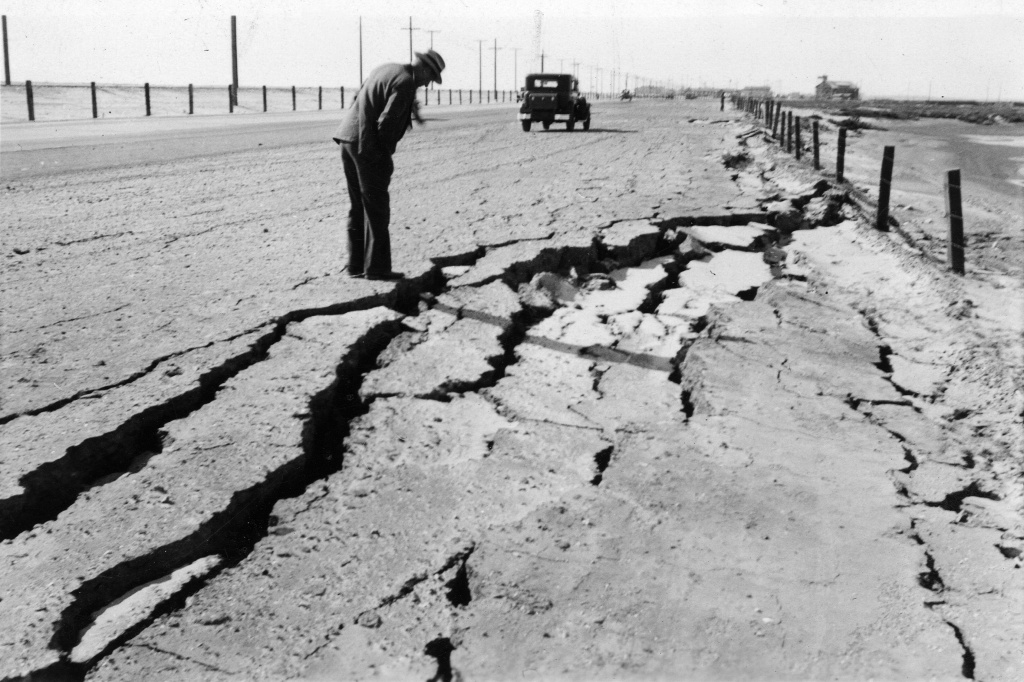 A roadway between Seal Beach and Bolsa Chica Gun Club is cracked in this file photo taken following an earthquake in Long Beach, California, on March 10, 1933.