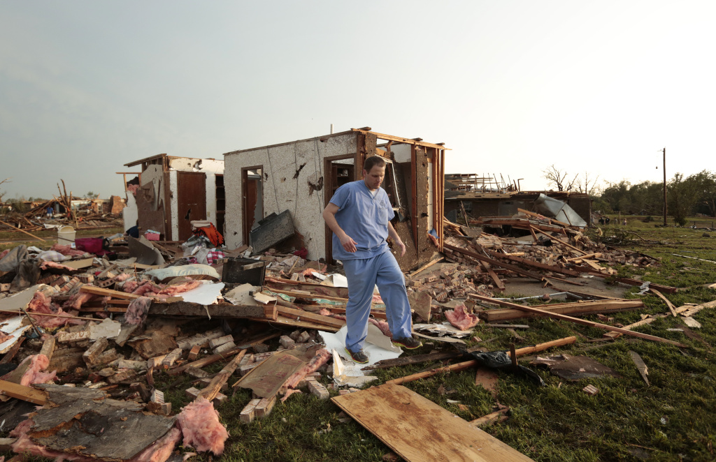 Nathan Ulepich searches outside the back of his house destroyed after a powerful tornado ripped through the area on May 20, 2013 in Moore, Okla.