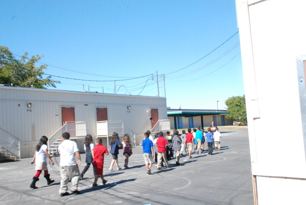 Most of Ronzone's students are Latino and rely on a free and reduced lunch program. Many of the elementary schools with the highest numbers of portable classrooms have a similar profile.