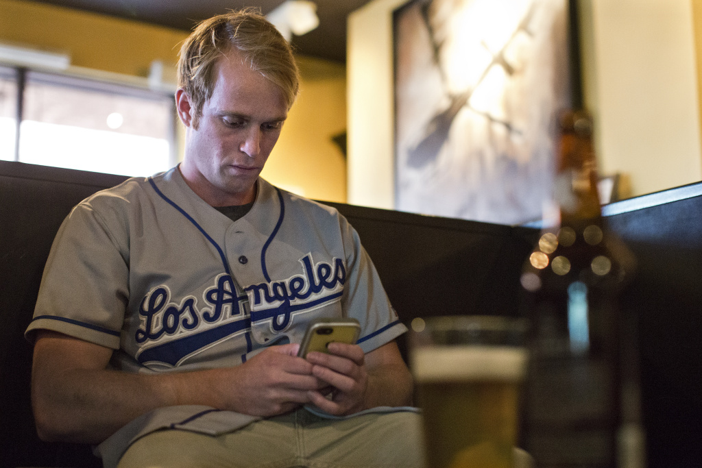Andrew Fosworthy waits for friends before a Dodgers game at Sunset Beer Co. on Tuesday, July 29.