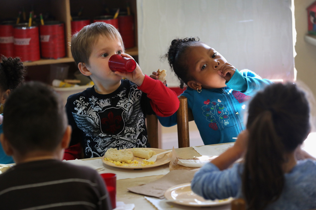 Children eat breakfast at the federally-funded Head Start Program school on September 20, 2012 in Woodbourne, New York.