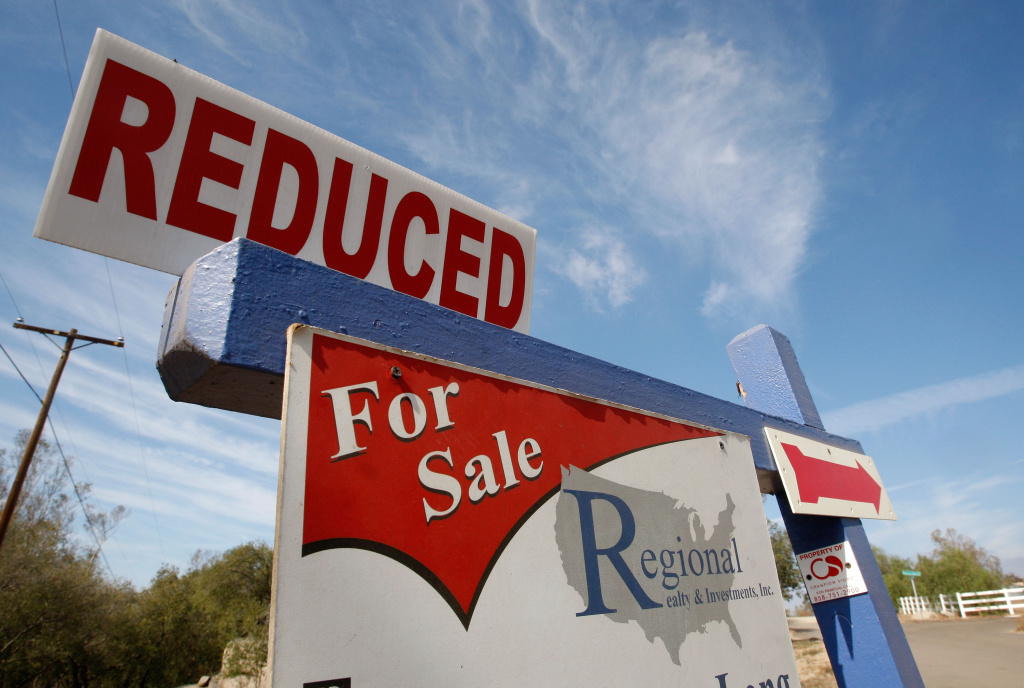 A real estate for sale sign offers a reduced price October 30, 2007 in Ramona, California.