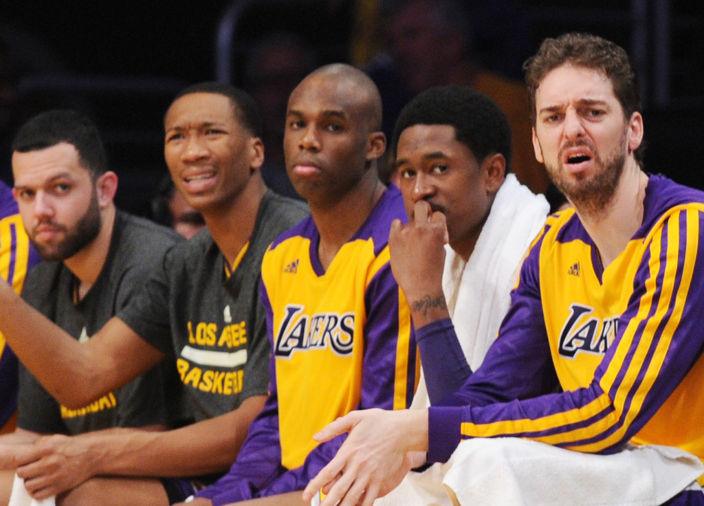 Los Angeles Lakers Pau Gasol (R) sits on the bench with his teammates in the fourth quarter against the Los Angeles Lakers March 6, 2014 at Staples Center in Los Angeles, California. The Clippers defeated the Lakers 142-94.