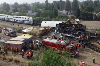 Rescue crews use heavy equipment to dismantle the damaged trains and continue to search for survivors at the site of a train crash on Sept. 13, 2008 in Chatsworth, Calif.