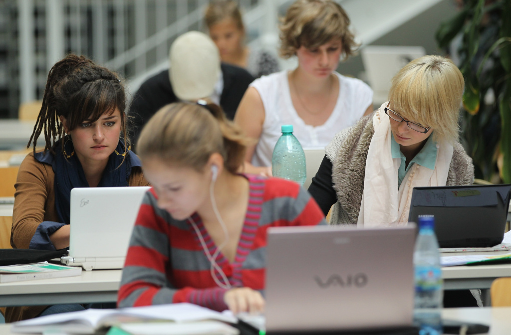 Students study with their laptop computers in the Pedagogical Library at the Freie Universitaet university on September 20, 2011 in Berlin, Germany. In the U.S., Professor Daniel Rockmore has made a case in the New Yorker towards banning the use of laptops in college classrooms.